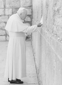 Pope John Paul II places a signed note into a crack in the Western Wall in Israel. (AP/WIDE WORLD PHOTOS)