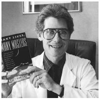 Dr. Brian Weiss with his book on reincarnation. One of his patients in his book claims to have 86 past lives. (AP/WIDE WORLD PHOTOS)