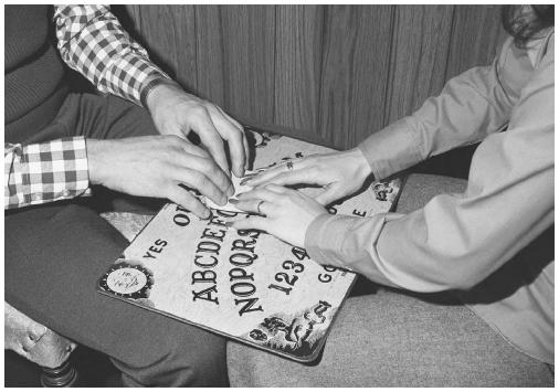 Ouija boards were created in the 1890s and used by spirit mediums to contact people in the afterlife. It was used in seances and as a parlor game. (CORBIS CORPORATION)