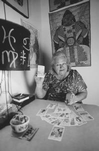 Female tarot card reader displaying a prediction. (CORBIS CORPORATION)