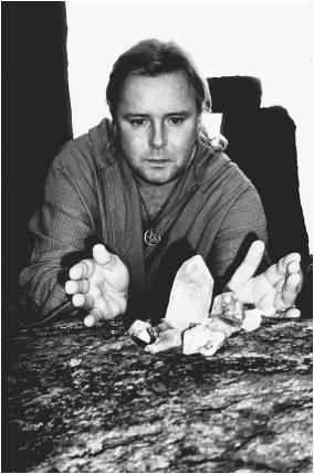 White witch Kevin Carlyon working with crystals at Stonehenge. (KEVIN CARLYON/FORTEAN PICTURE LIBRARY)