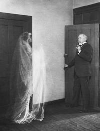 Ghost image of a woman frightening an elderly man in a double exposed film from ca. 1910. (CORBIS CORPORATION)