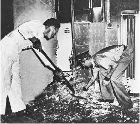Men sifting through the aftermath of an alleged spontaneous combustion incident. (FORTEAN PICTURE LIBRARY)